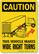 Caution Vehicle Makes Wide Right Turns Sign