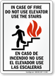 In Case Of Fire Use Stair Bilingual Sign