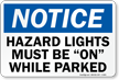 Hazard Lights Must Be On Notice Sign
