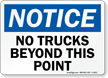 No Trucks Beyond Point Sign