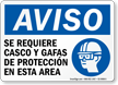Spanish Helmet and Goggles Required In Area Sign