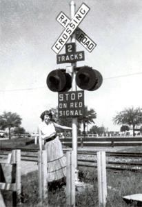 1955 crossbuck sign at train tracks