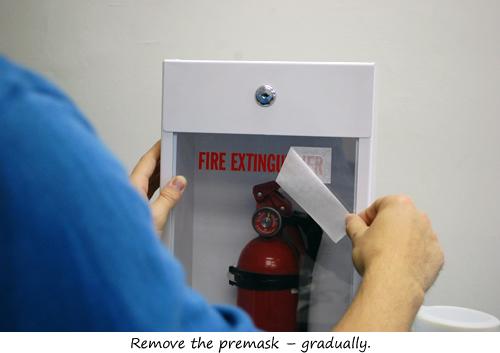 Die-cut fire extinguisher sign