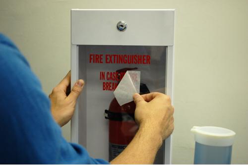 Installing a Fire Extinguisher Sticker