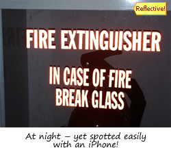 Reflective fire extinguisher sign