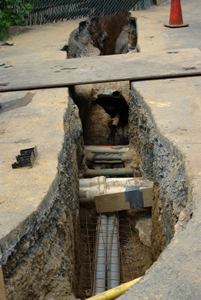 Trench with hidden pipes
