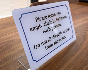 Do not sit across from anyone sign