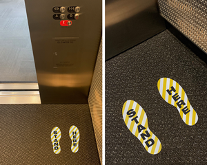 Elevator stand here footprint markers