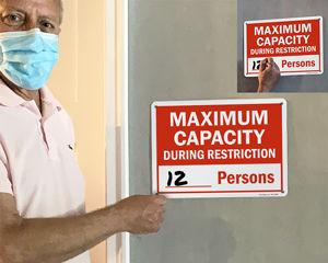 Maximum capacity signs for social distancing