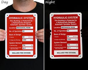 Fire sprinkler identification signs