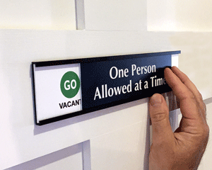 One person in bathroom at a time sign for social distancing