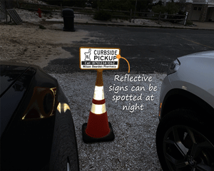 Curbside sign is reflective and can be seen at night