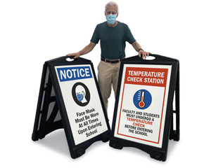 Wear a mask signs and check temperature signs for school entrance