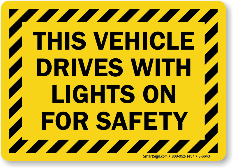 Vehicle Drives With Lights On For Safety Sign
