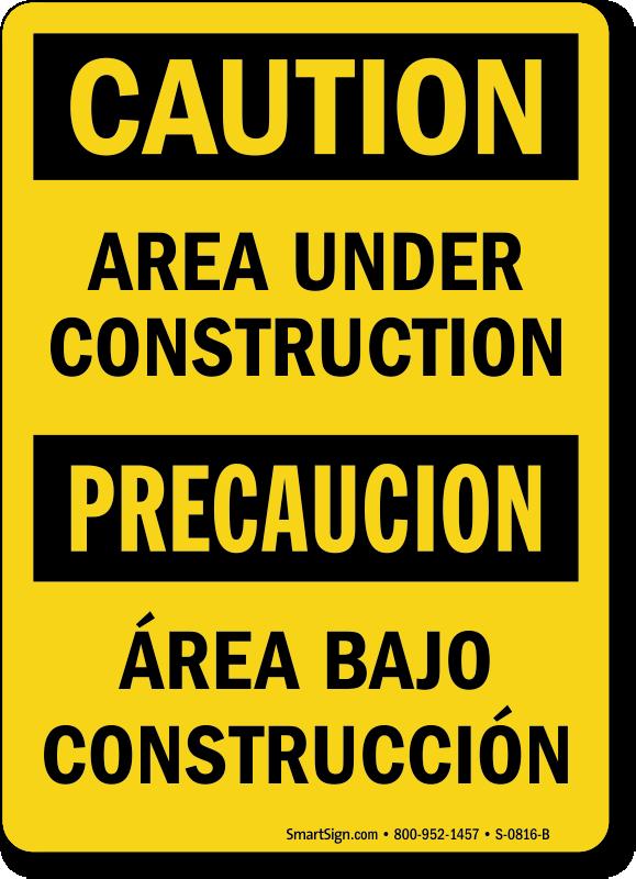 Bilingual Caution Area Under Construction Sign