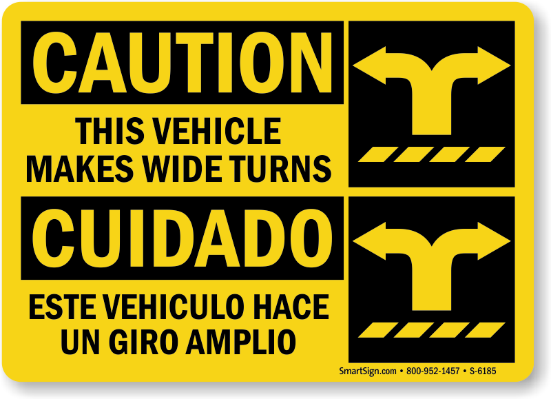 Bilingual Vehicle Makes Wide Turns Caution Sign