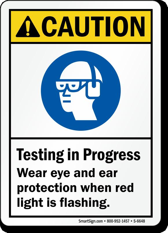 Testing In Progress Wear Eye, Ear Protection Sign