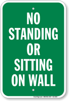 No Standing Or Sitting On Wall Sign