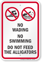 No Wading, Swimming or Feeding Alligators Sign