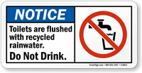 Toilets Are Flushed with Recycled Rainwater Sign