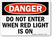 Danger Do Not Enter When Red Light is On Sign