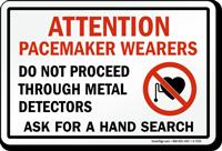 Do Not Proceed Through Metal Detectors Sign