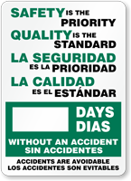 Bilingual Safety Priority. Quality Standard. La Seguridad Sign
