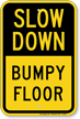 Slow Down Bumpy Floor Sign