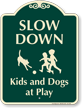 Slow Down Kids And Dogs At Play Sign