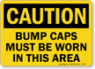 Caution Bump Caps Must Be Worn Sign