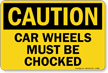 Car Wheels Must be Chocked Sign