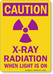 Caution: X-Ray Radiation When Light Is On Sign