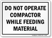 Do Not Operate Compactor While Feeding Material Sign