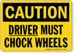 Caution Driver Must Chock Wheels Sign