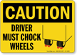 Driver Must Chock Wheels Caution Sign