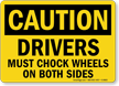 Caution Drivers Must Chock Wheels Sign
