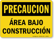 Spanish OSHA Caution Area Under Construction Sign