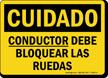 Spanish OSHA Caution Driver Must Chock Wheels Sign