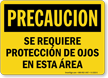 Spanish OSHA Caution Eye Protection Required In This Area Sign