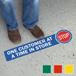 Stop One Customer At A Time In Store SlipSafe Floor Sign