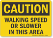 Walking Speed Or Slower In This Area OSHA Caution Sign