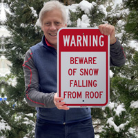 Beware of snow falling from roof sign