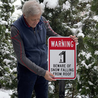 Beware of snow falling from the roof warning sign