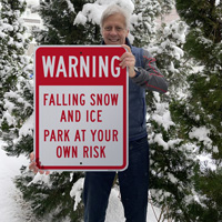 Falling ice and snow park at your own risk sign