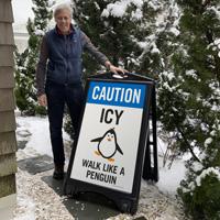 Walk like a penguin on ice sidewalk sign