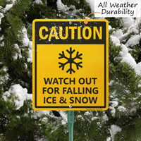 Watch out for falling snow sign with stake