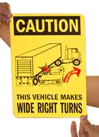 Caution Vehicle Makes Wide Right Turns Signs