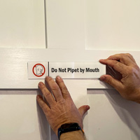 Do Not Pipet By Mouth Sign on a Door