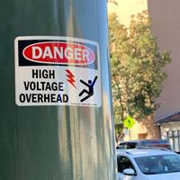 High voltage overhead danger sign