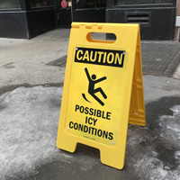 Icy conditions warning sign for sidewalk
